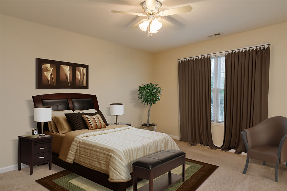 Villas of Victor & Regency Townhomes offers a cozy bedroom in Victor, New York