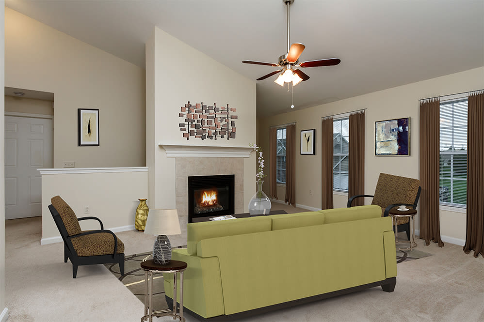 Living room with a fireplace at Villas of Victor & Regency Townhomes in Victor, New York