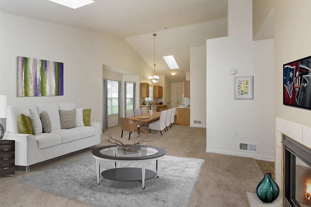 Modern living room at Villas of Victor and Regency Townhomes in Victor, NY