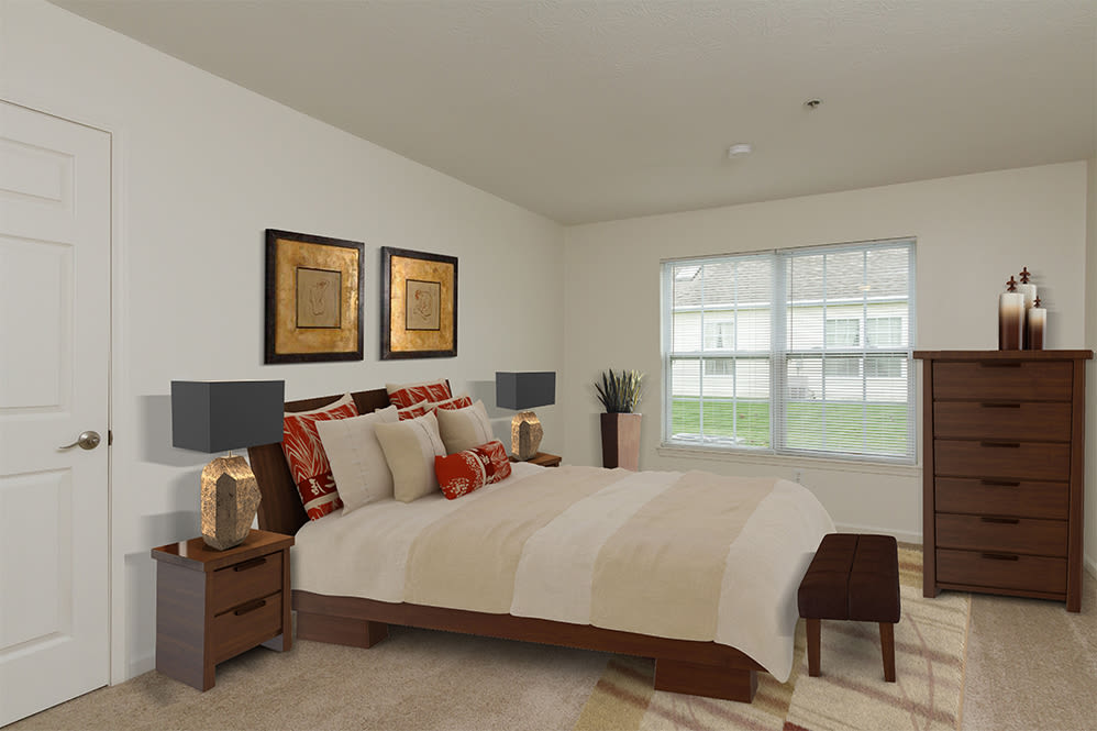 Well decorated bedroom at Villas of Victor & Regency Townhomes in Victor, New York