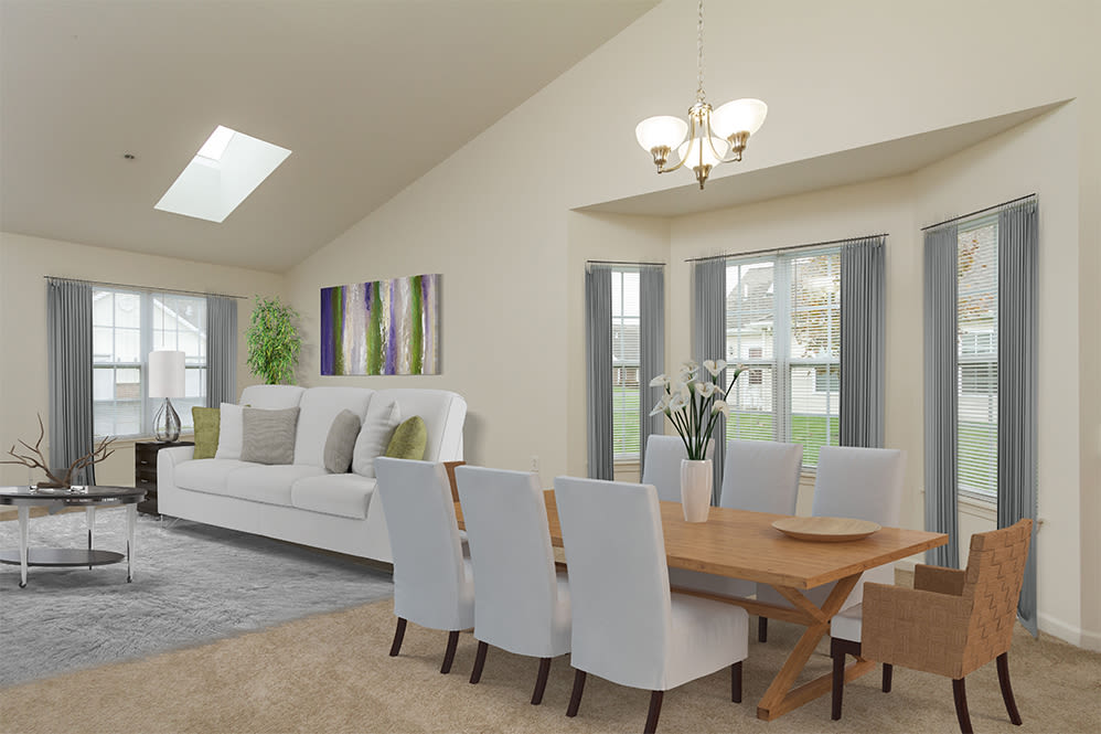 Living and dining room view at Villas of Victor and Regency Townhomes in Victor, NY