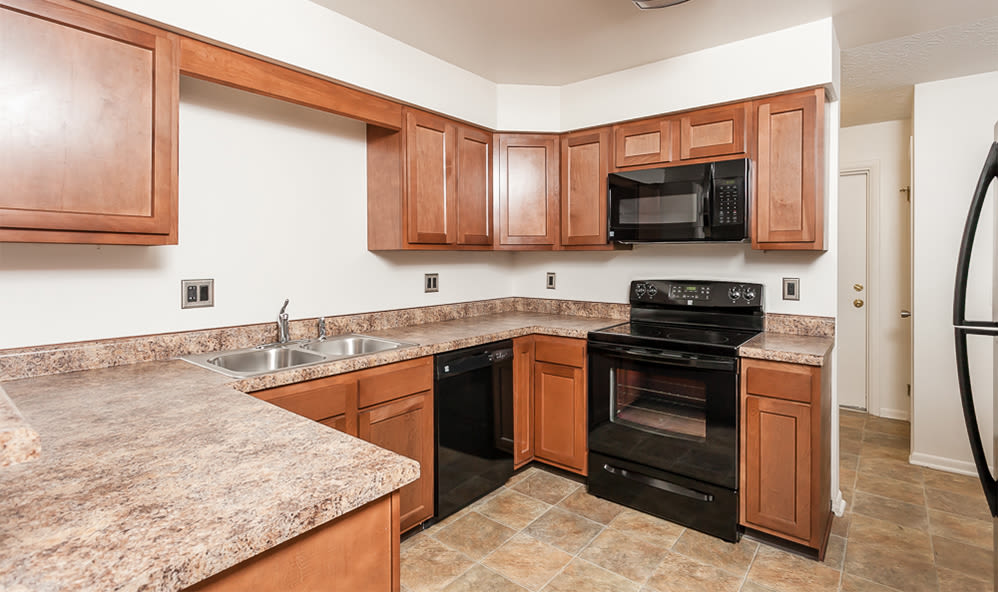 Well-equipped kitchen at CenterPointe Apartments and Townhomes home in Canandaigua, NY