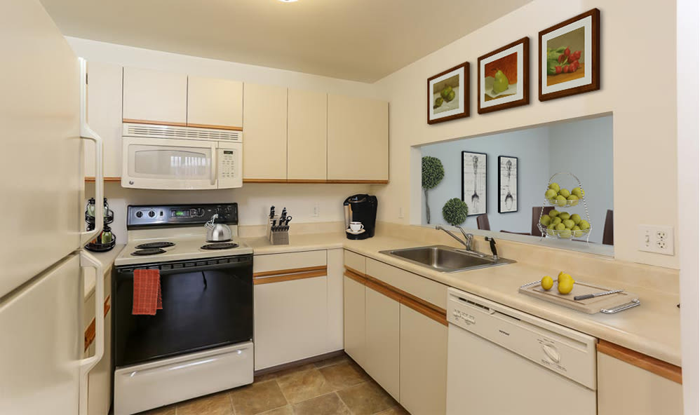 Fully-equipped kitchen at CenterPointe Apartments and Townhomes home in Canandaigua, New York