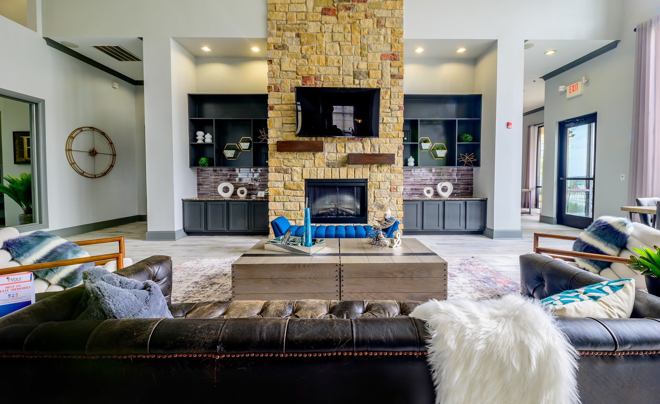 Modern decor in spacious living room of model home at Evolv in Mansfield, Texas