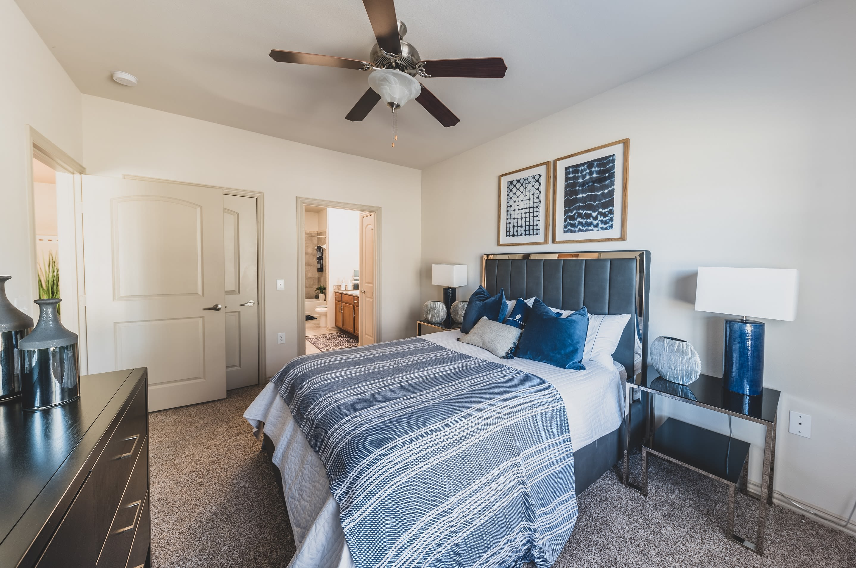 Bright and well-decorated master bedroom in model home at Evolv in Mansfield, Texas