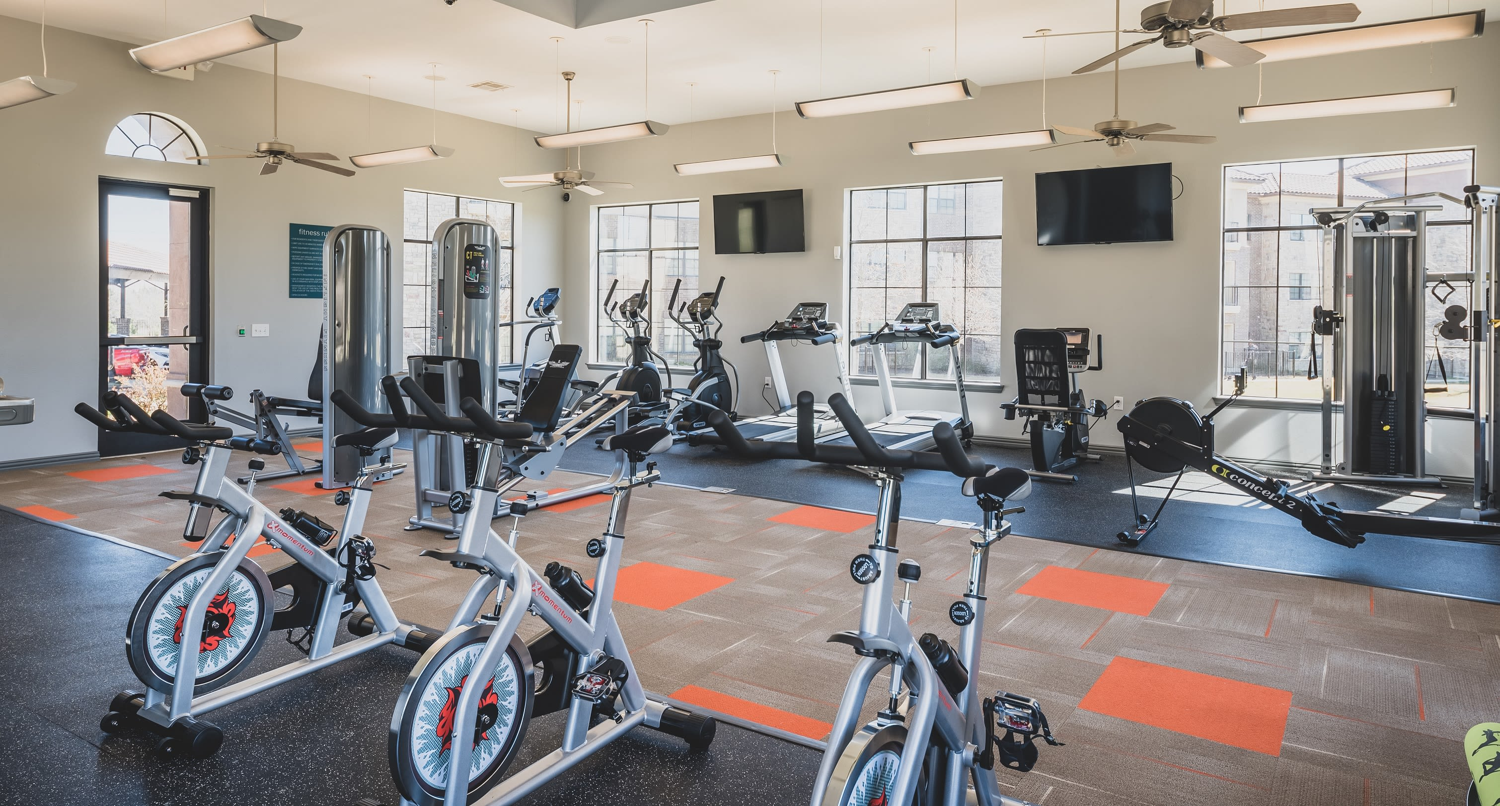 Plenty of indoor fitness bikes at Evolv in Mansfield, Texas