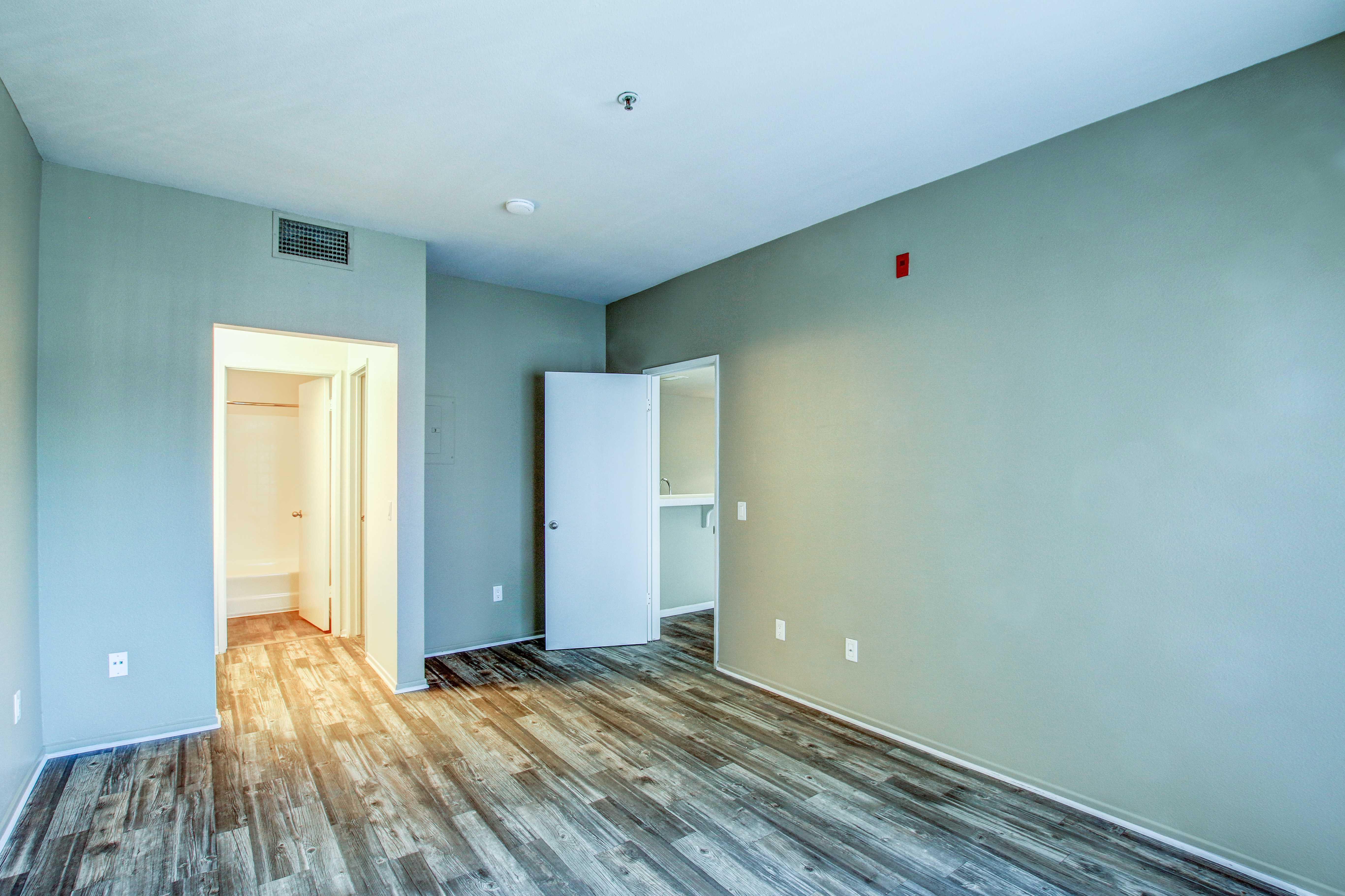 Bedroom with hardwood flooring in San Diego, California