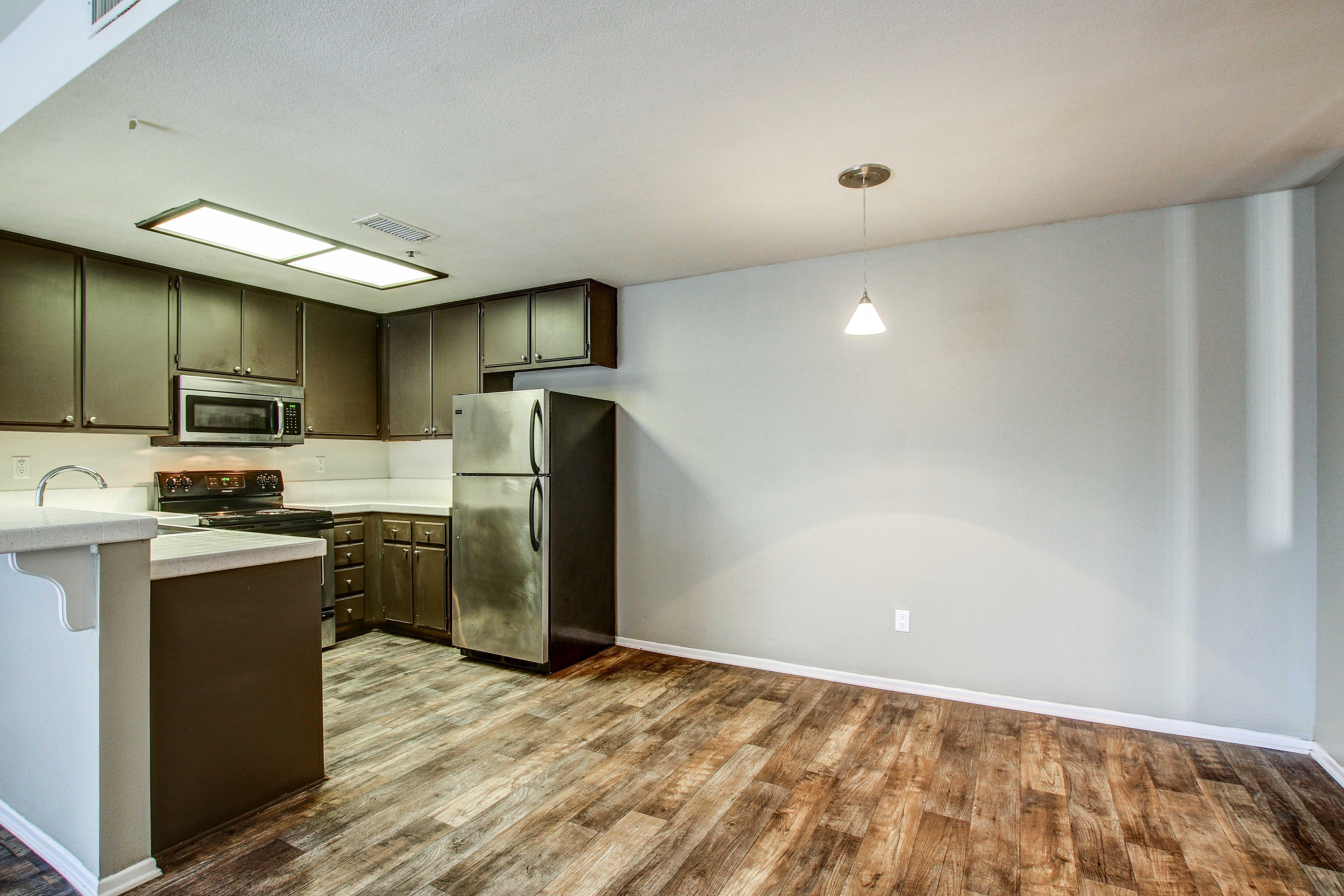 Beautiful kitchen with hardwood floors in San Diego, California
