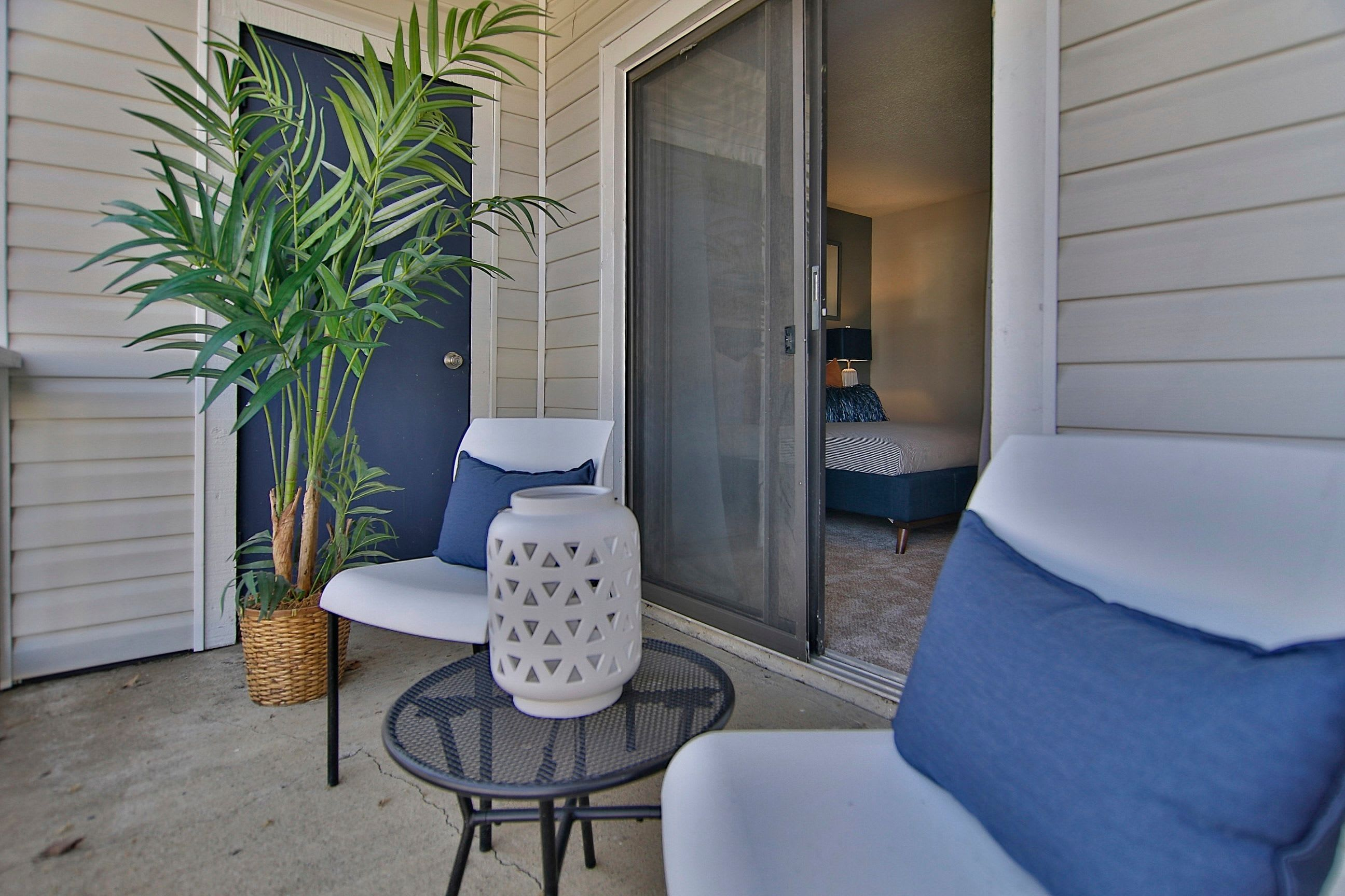 Porch with outdoor seating adjacent to bedroom at Lyric on Bell in Antioch, Tennessee