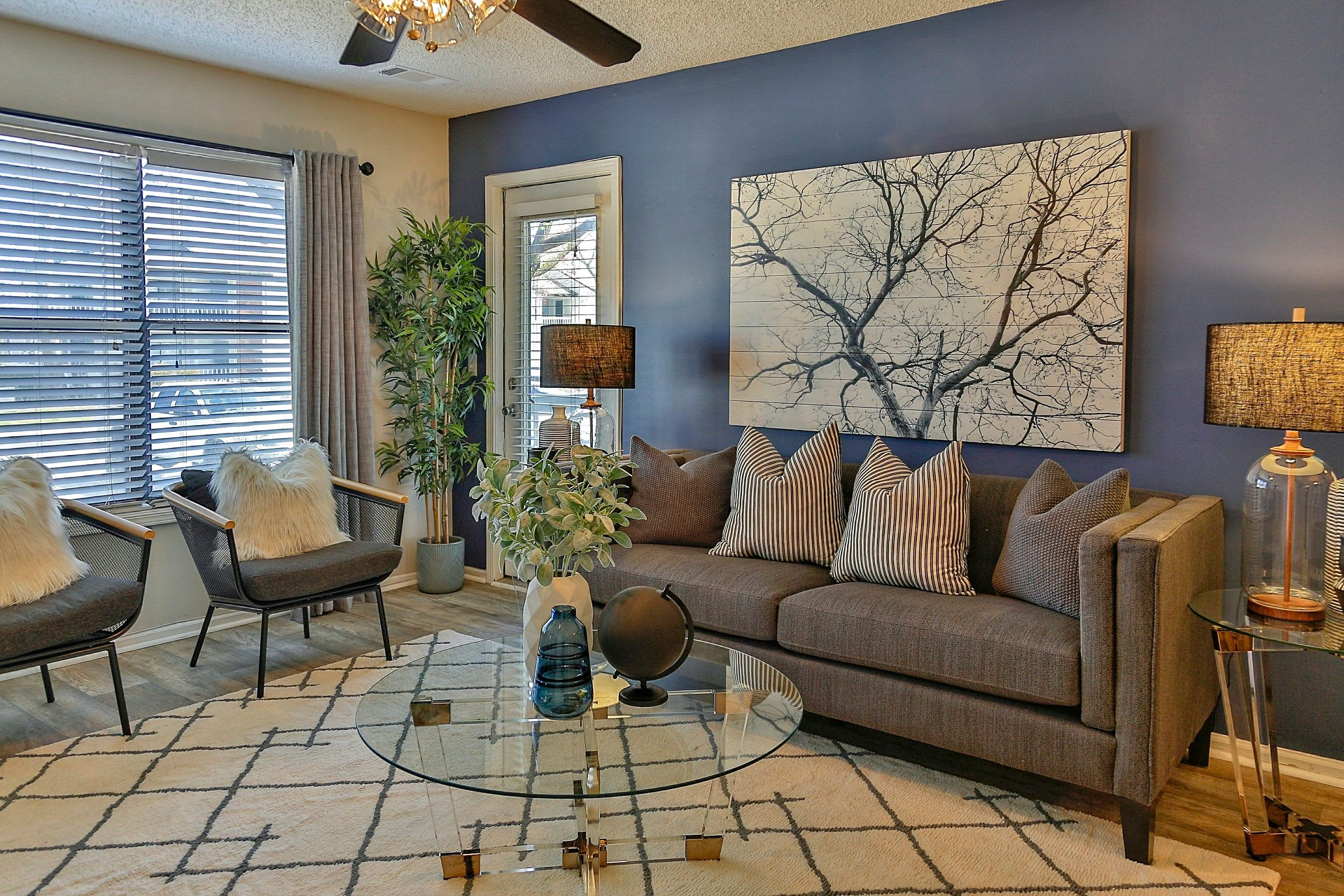 Living room with hardwood floors and custom lighting in model home at Lyric on Bell in Antioch, Tennessee