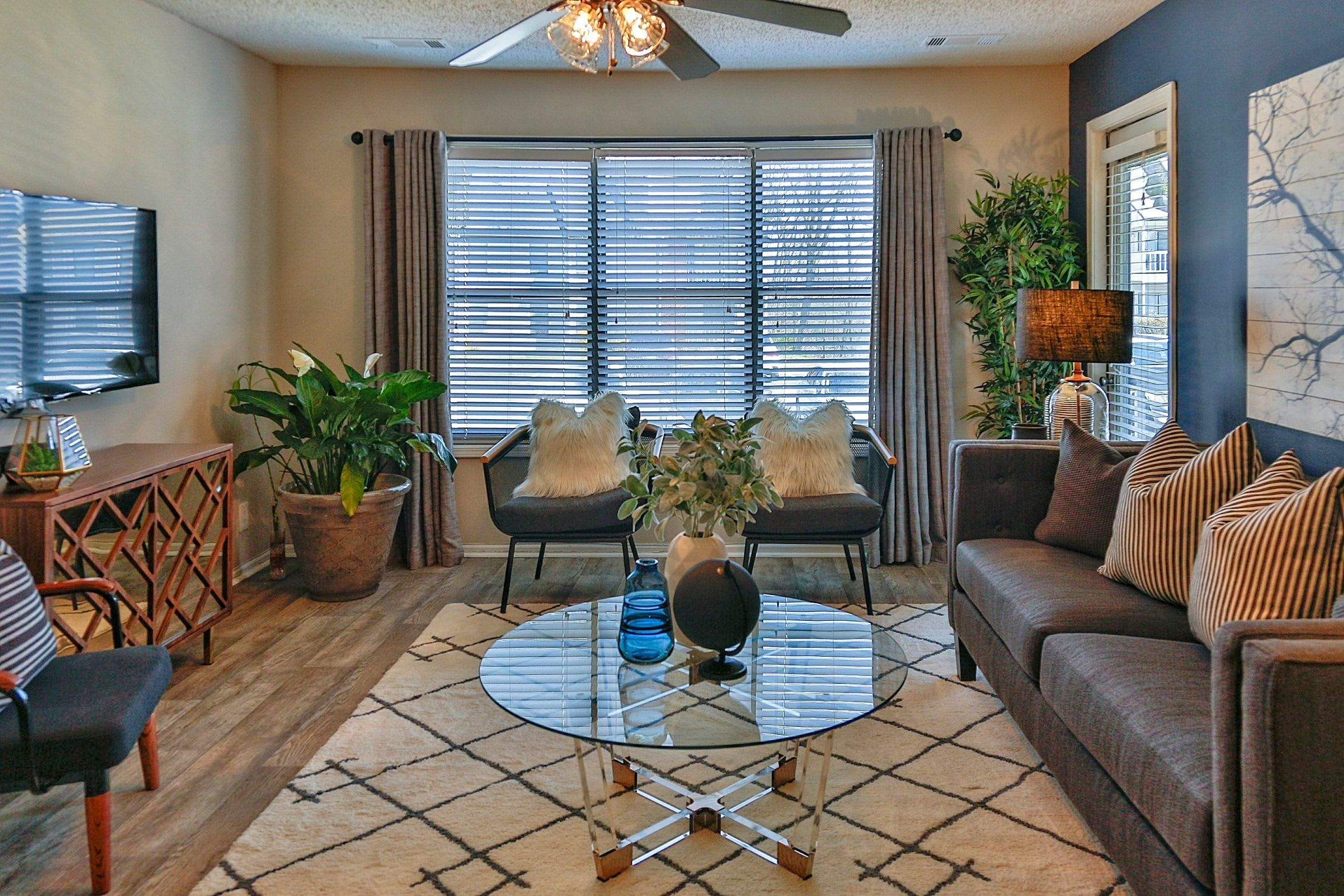 Comfortable seating and modern decor in the resident apartment at Lyric on Bell in Antioch, Tennessee