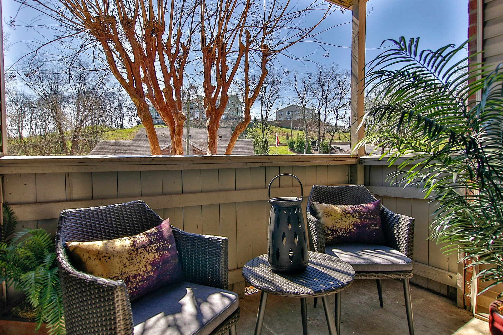 Back porch with outdoor furniture and trees at Allegro on Bell in Antioch, Tennessee