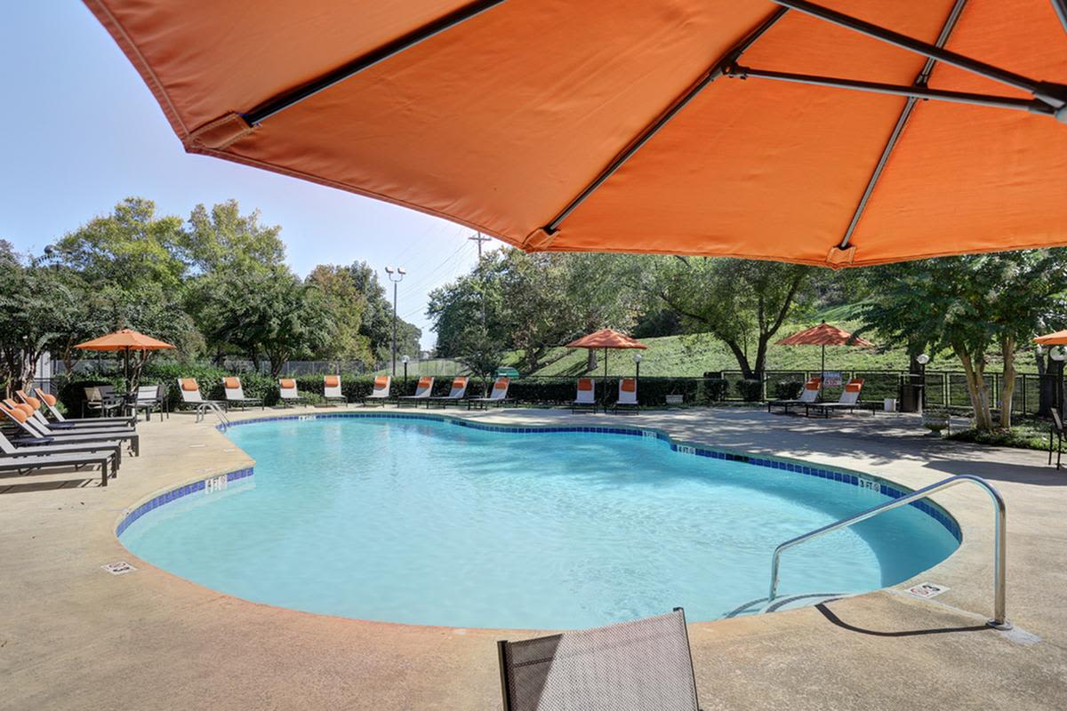 Shaded seats with umbrella at swimming pool at Allegro on Bell in Antioch, Tennessee