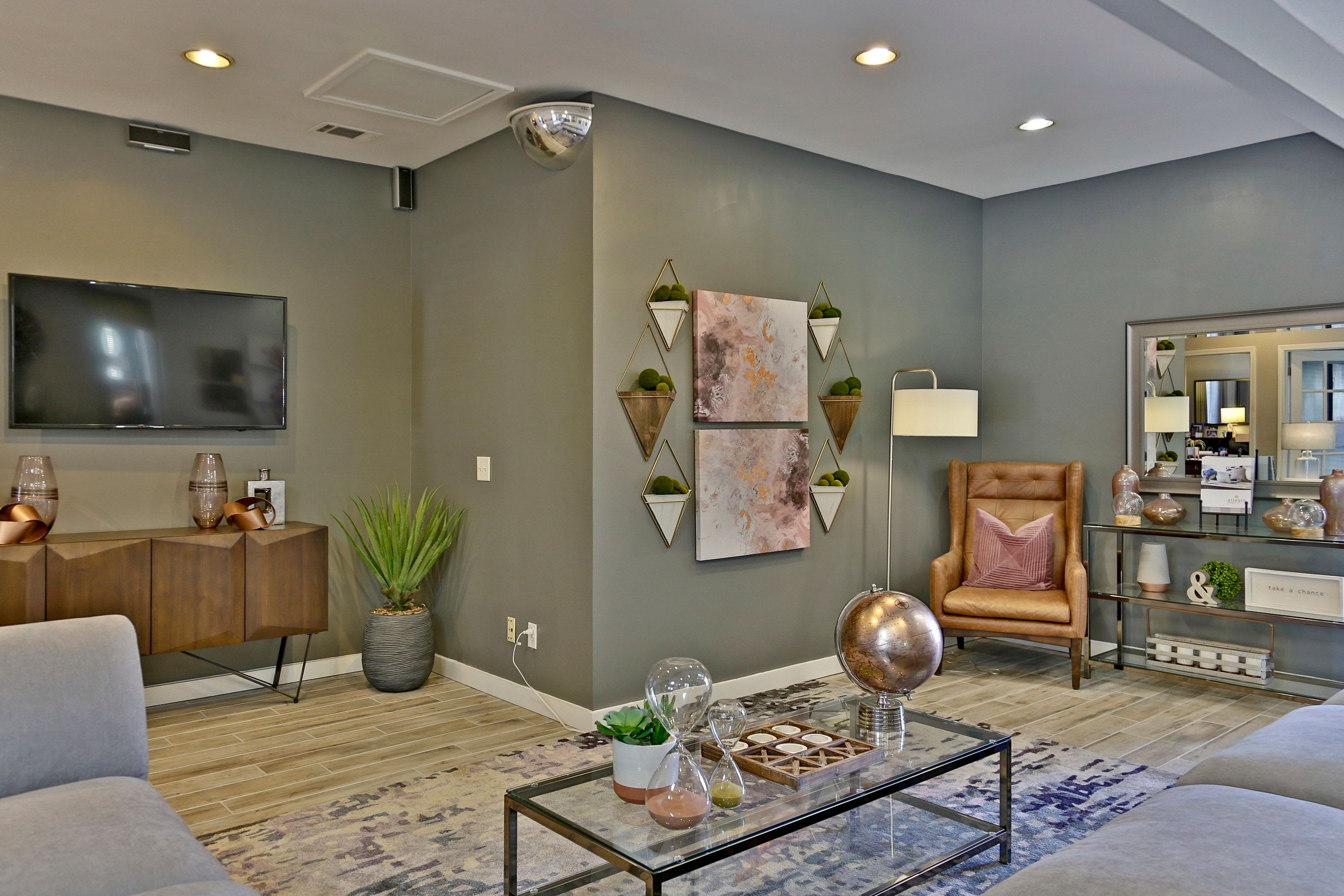Well decorated open concept floor plan in living room of model home at Allegro on Bell in Antioch, Tennessee