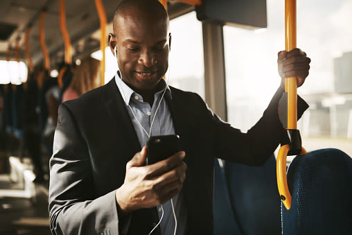 Man on the subway on his phone near Berkshire Stewards Crossing in Lawrenceville, New Jersey