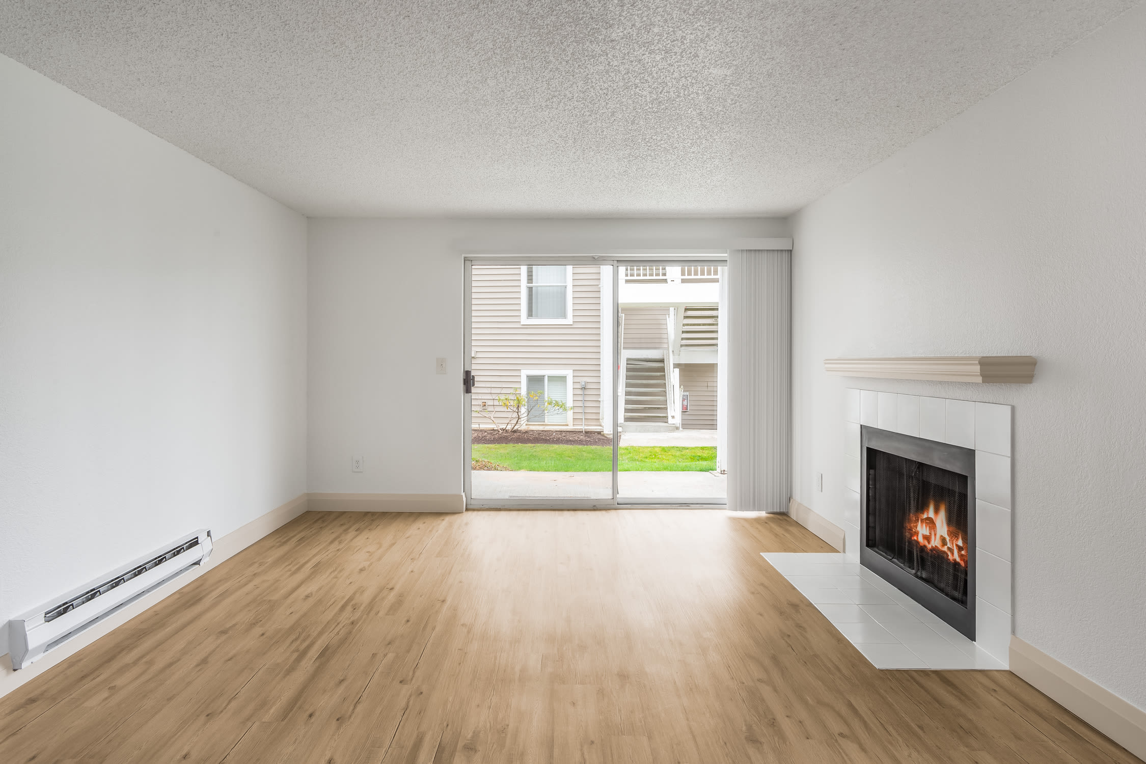 Living room with fireplace of Alaire Apartments in Renton, Washington