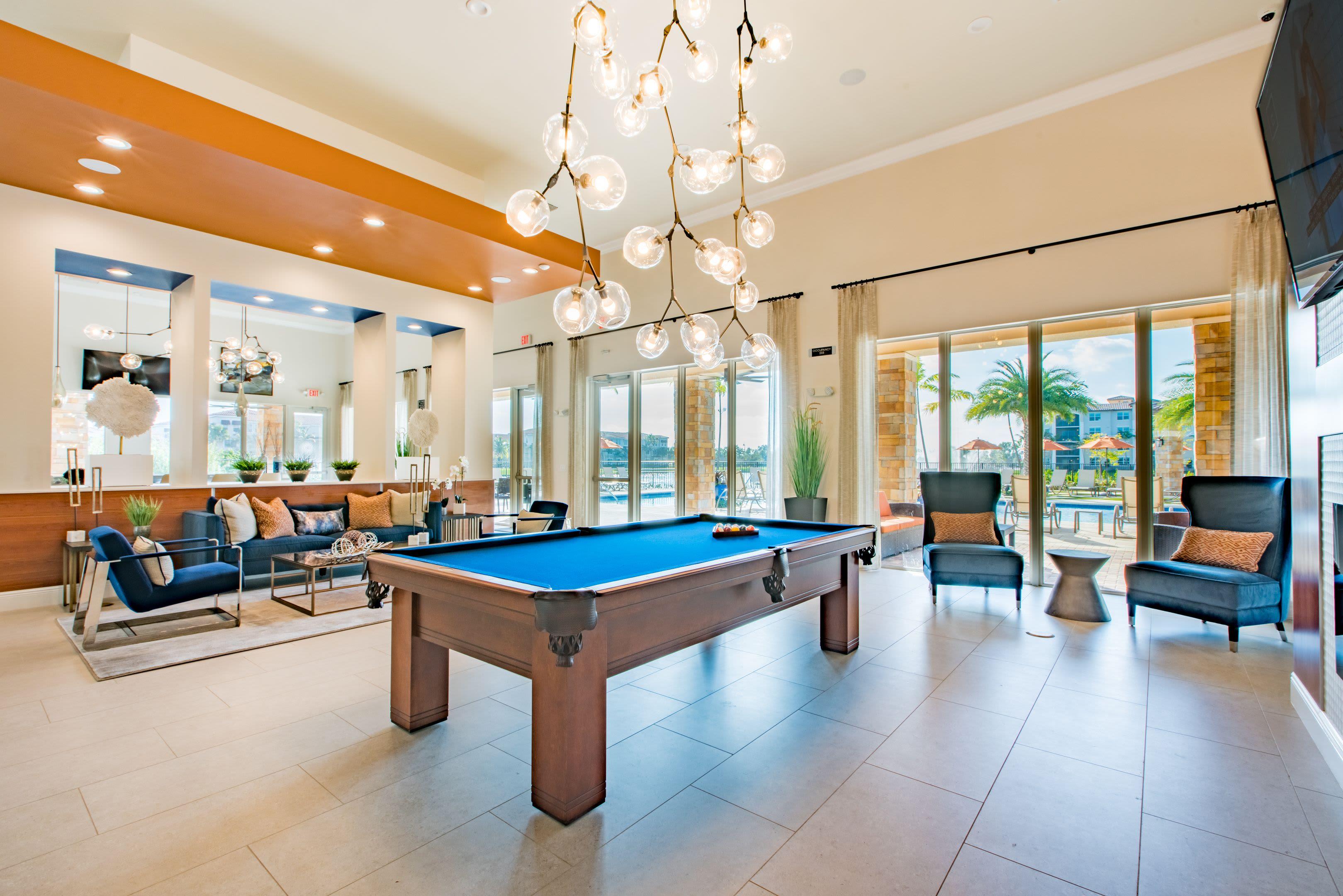 Resident Lounge & Billiards at Luma Miramar Apartments in Miramar, Florida.