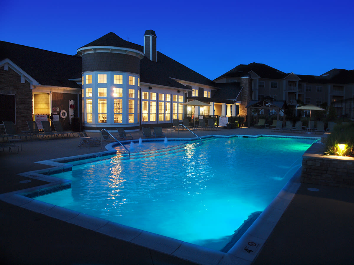 Clubhouse and outdoor pool at night at Meridian on Shelbyville in Louisville, Kentucky