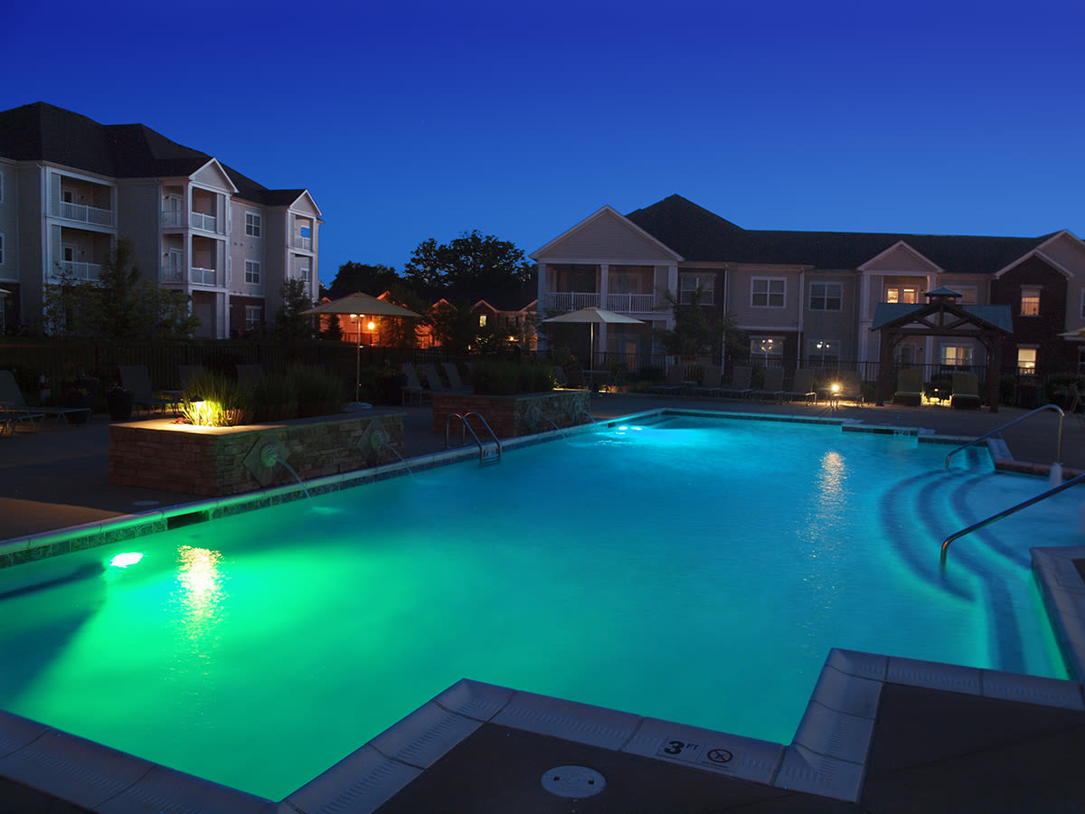 Outdoor pool lit up at night at Meridian on Shelbyville in Louisville, Kentucky