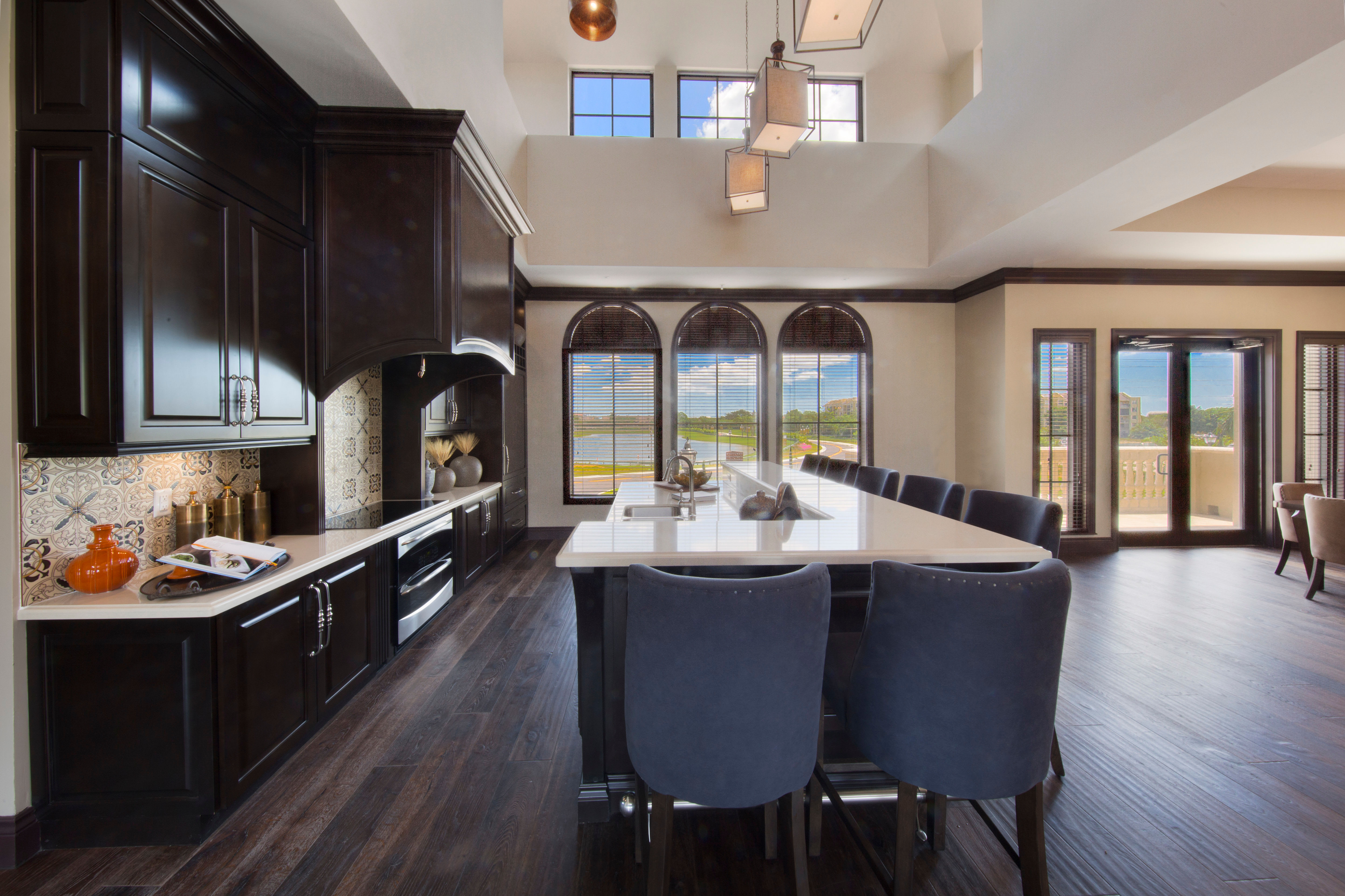 Gourmet kitchen with an island and granite countertops in a model home at Town Fontainebleau Lakes Apartment Residences in Miami, Florida