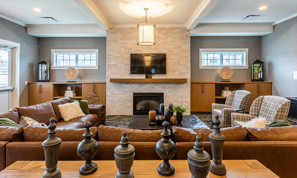 Beautiful clubhouse with seating and fireplace at Woodland Acres Townhomes