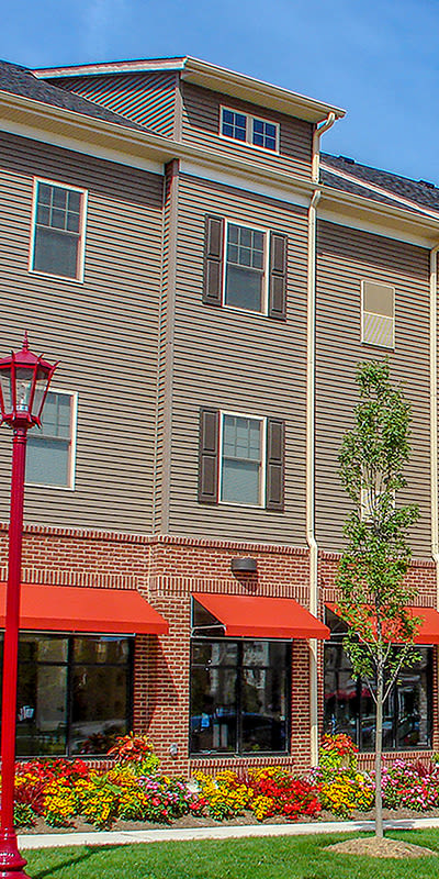 Front exterior view of apartments at Rochester Village Apartments at Park Place in Cranberry Township, PA