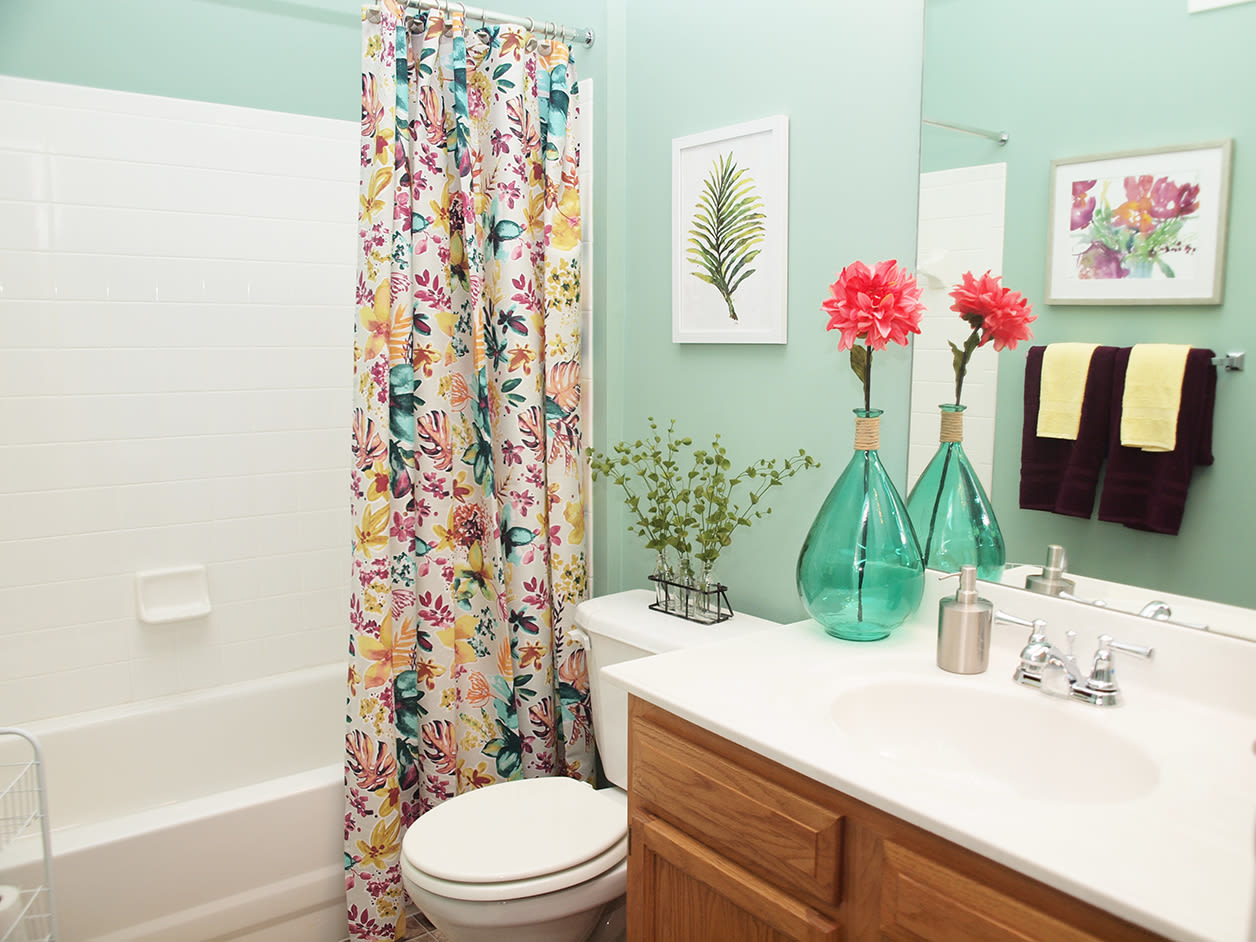 Bathroom featuring a shower and bathtub at Emerald Lakes in Greenwood, Indiana