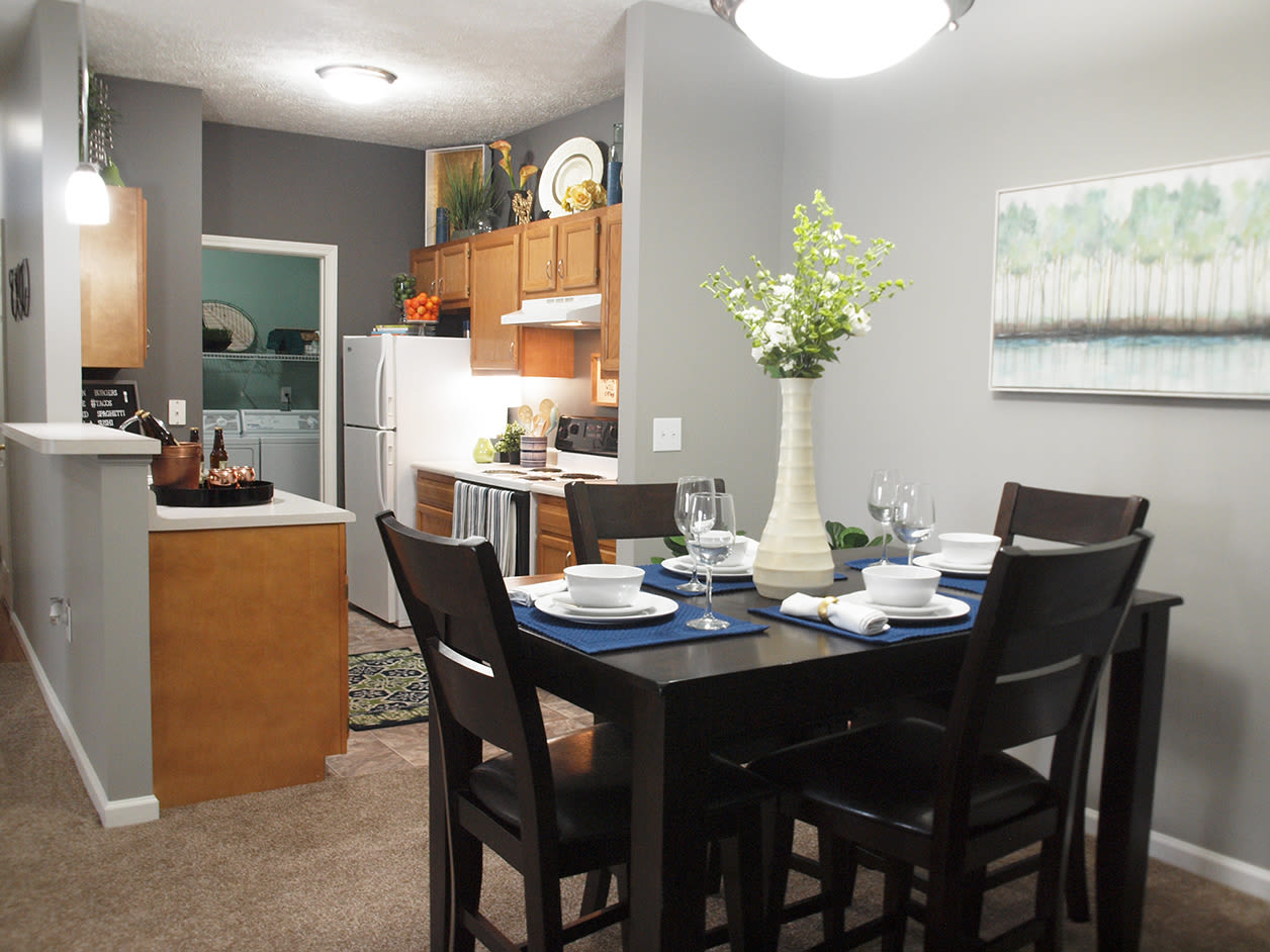 Dining room table and view of kitchen at Emerald Lakes in Greenwood, Indiana