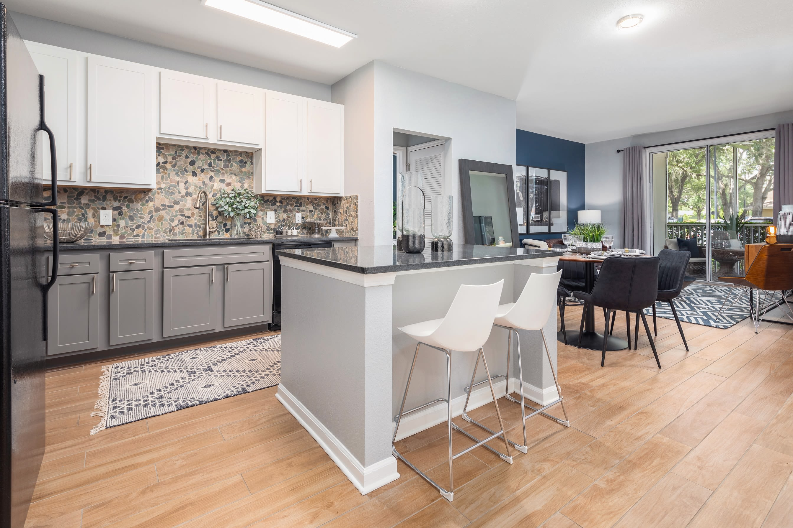 Open concept kitchen with wood floors at Luxe at 1820 in Tampa, Florida