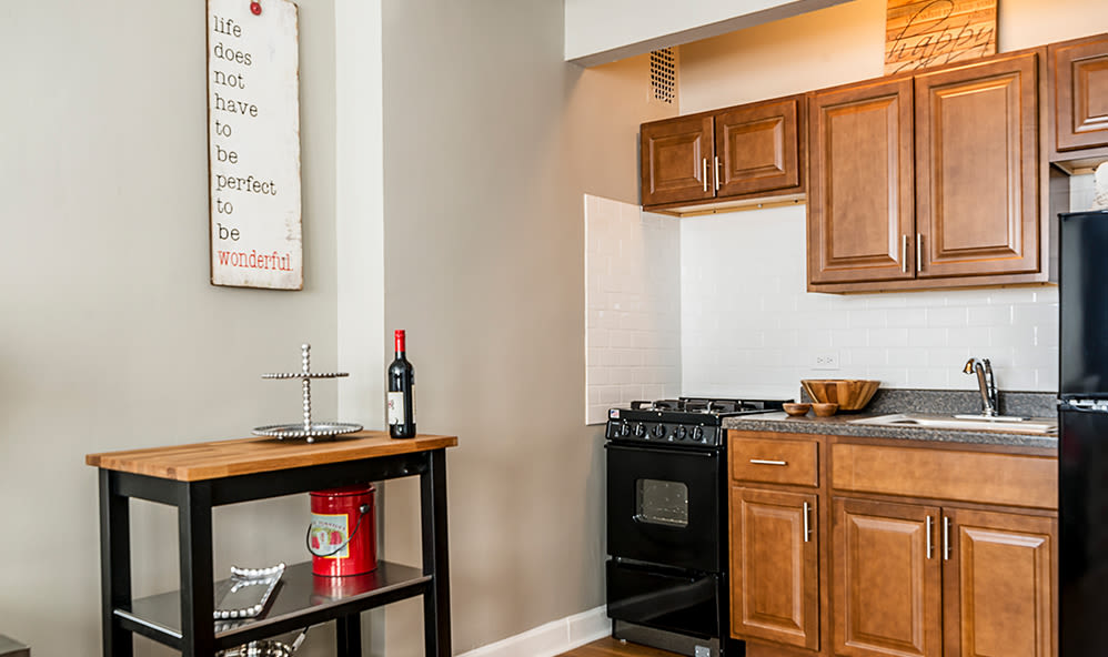 Fully-equipped kitchen at 7100 South Shore Apartment Homes in Chicago, Illinois