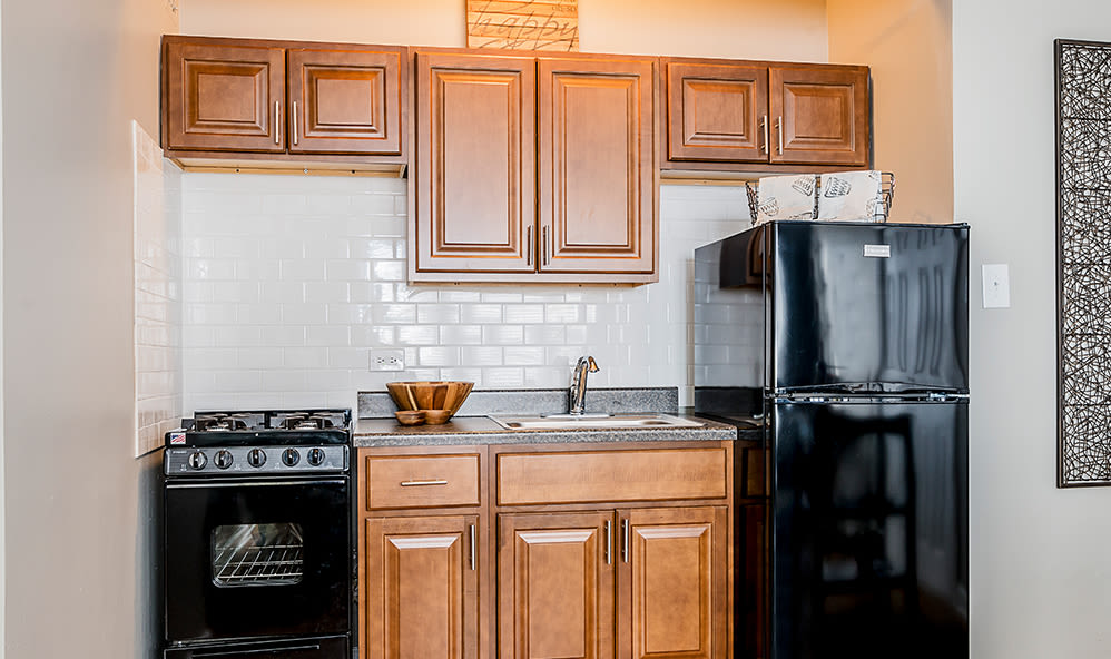 Full-equipped kitchen at 7100 South Shore Apartment Homes in Chicago, Illinois