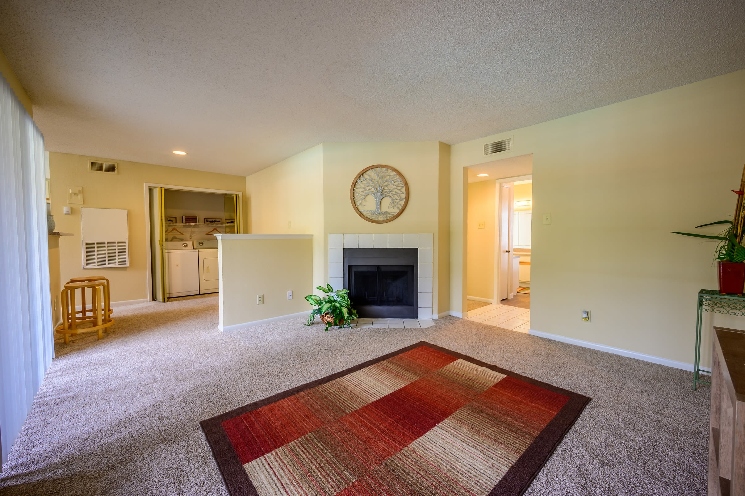 Large living room with a private balcony at Laurel Heights at Cityview in Fort Worth, Texas