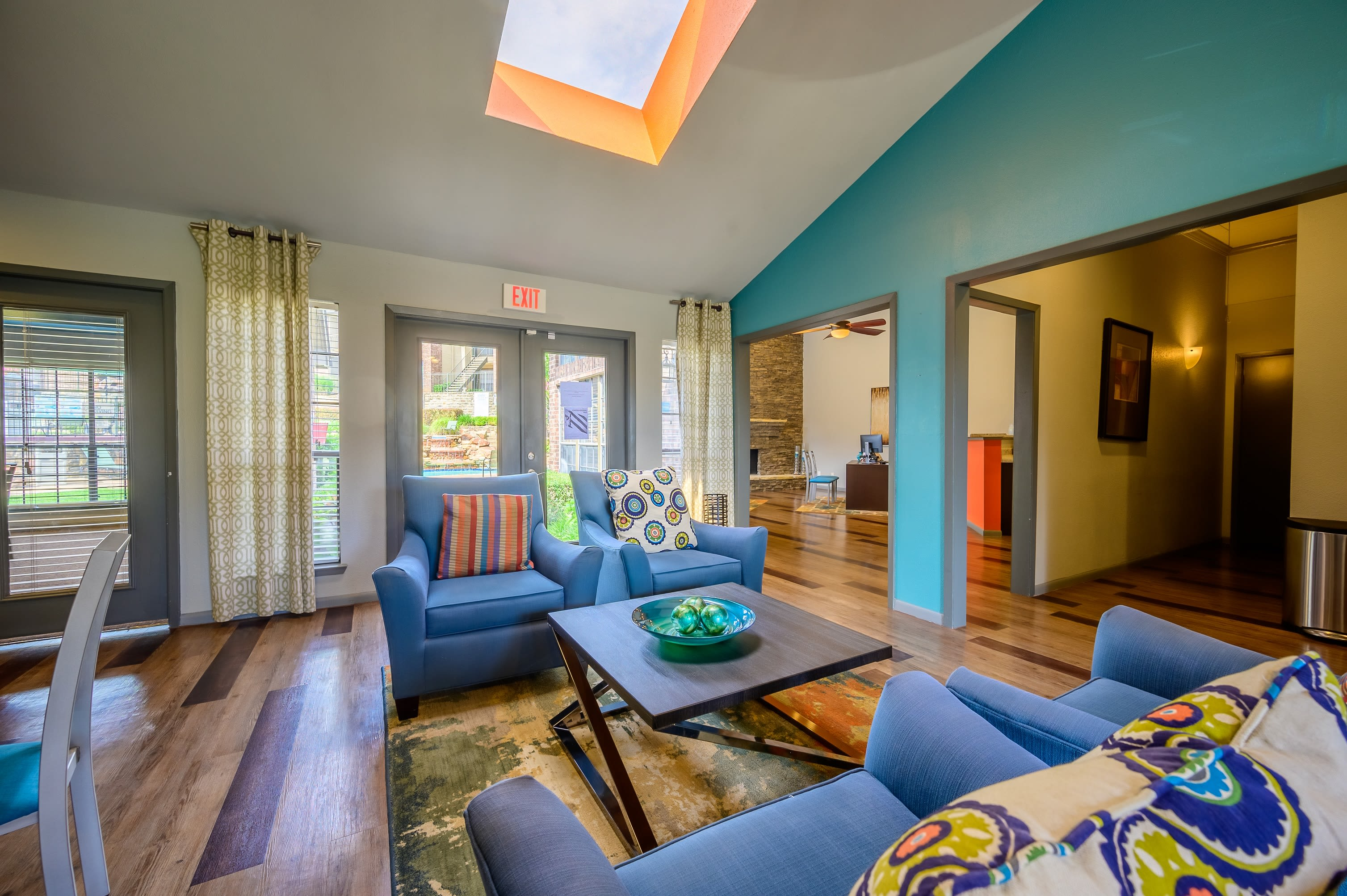 Large master bedroom with plush carpeting and a ceiling fan at Laurel Heights at Cityview in Fort Worth, Texas