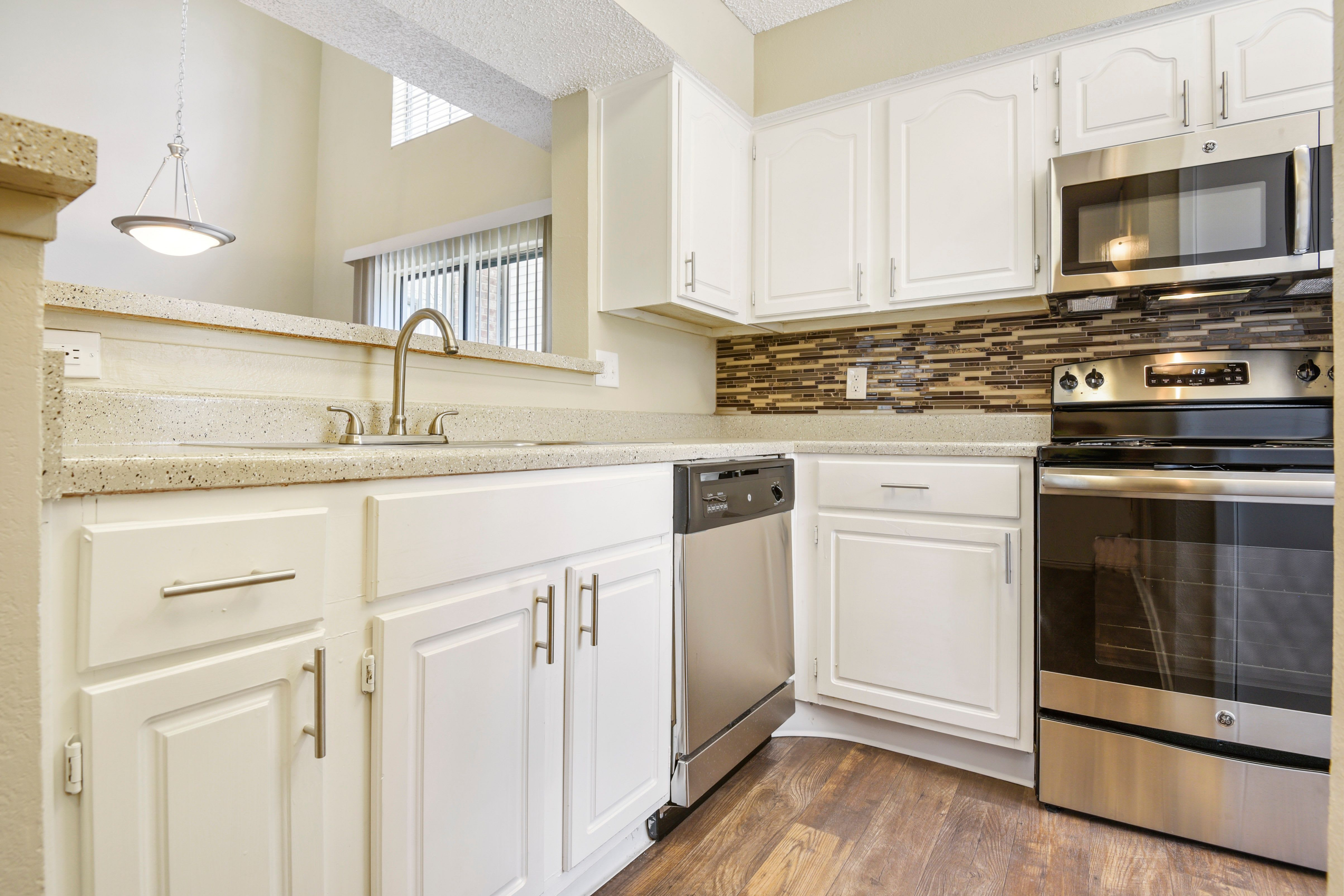 Stainless-steel appliances in kitchen at The Regent in Dallas, Texas