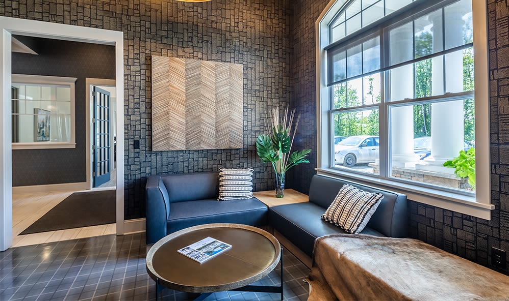 Naturally well-lit clubhouse at apartments in Webster, New York