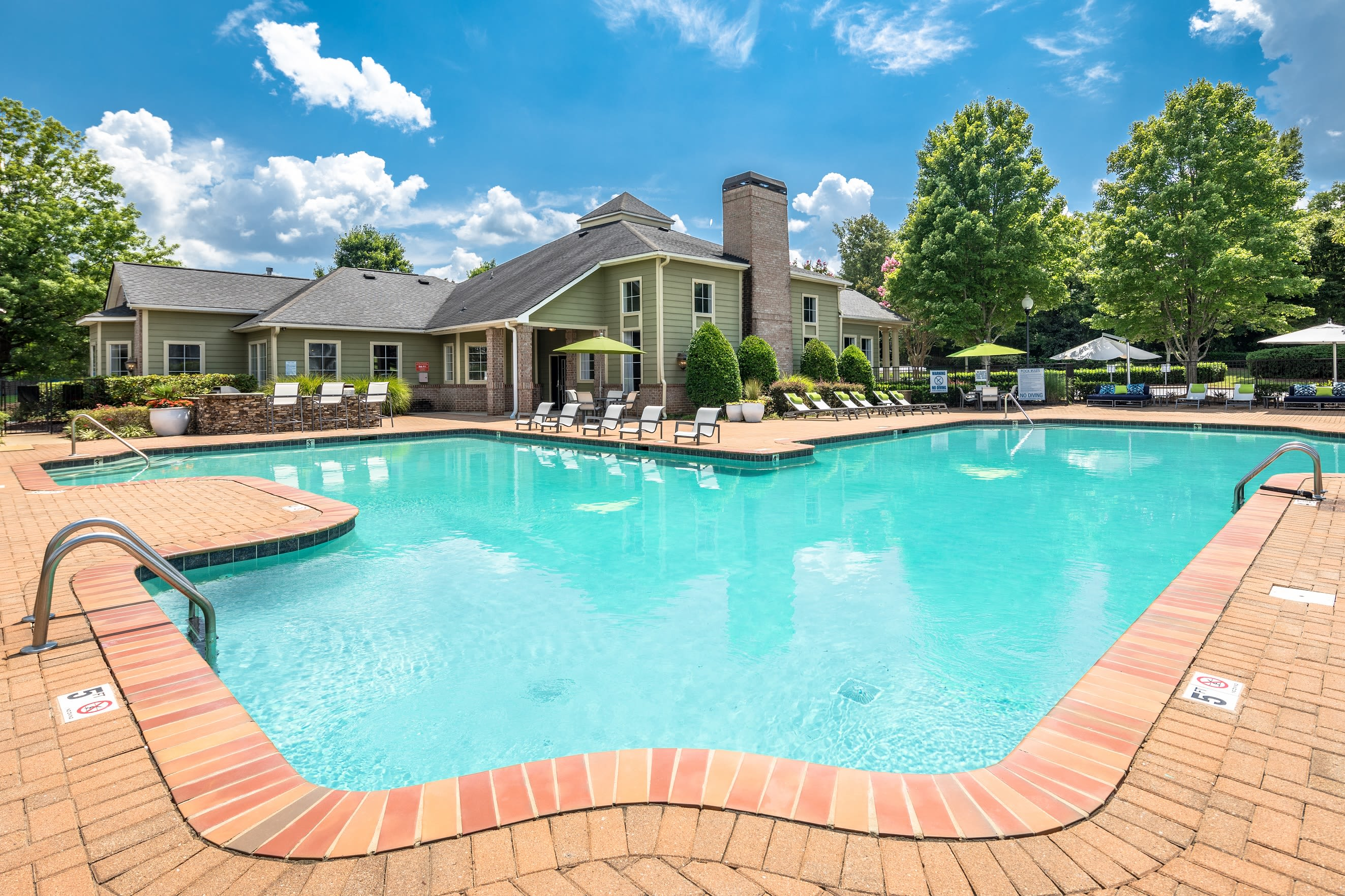 View of clubhouse by outdoor pool at Highlands at Alexander Pointe in Charlotte, North Carolina