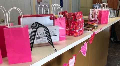 Candy and gifts decorated the counter at Lockaway Storage on Babcock Rd on Valentine's Day 2019