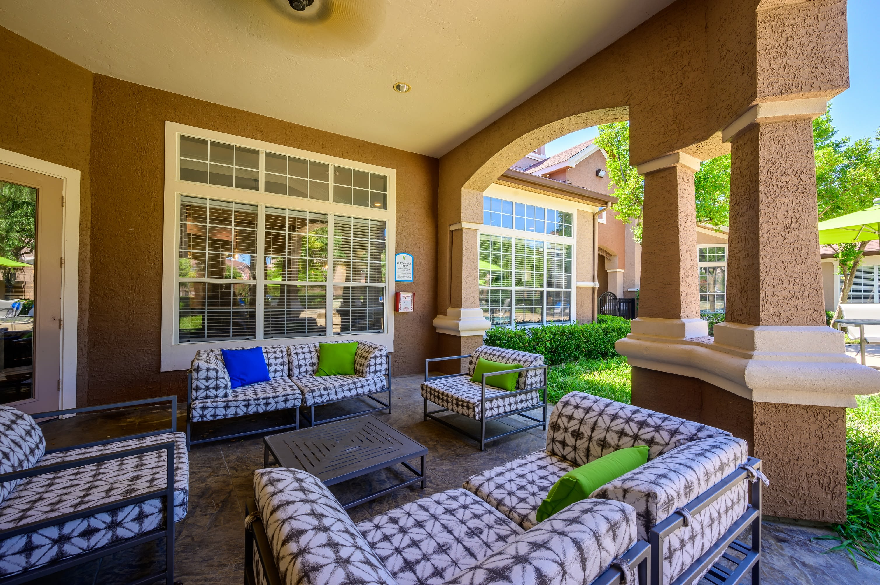 Courtyard with large swimming pool on a beautiful sunny day at The View at Lakeside in Lewisville, Texas