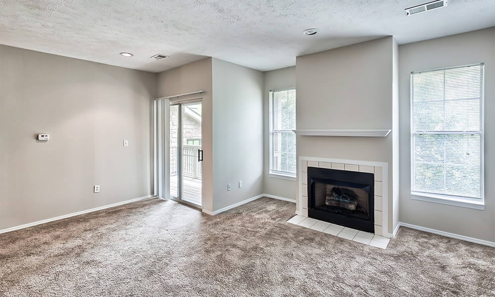 Naturally well-lit living room at Highlands of Montour Run in Coraopolis, Pennsylvania