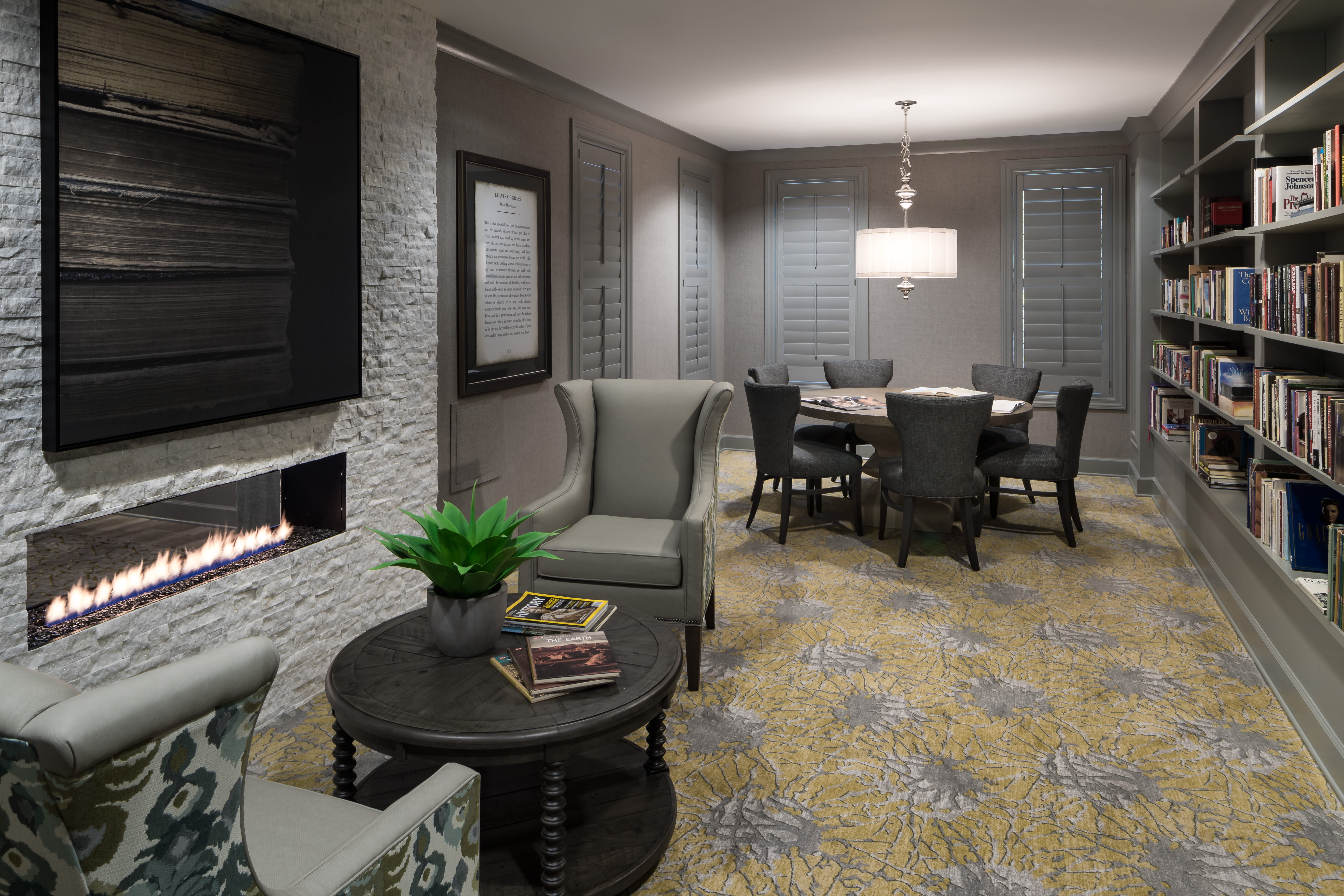 fireplace seating and lounge room at Avenida Cool Springs Active Senior Living in Franklin, TN