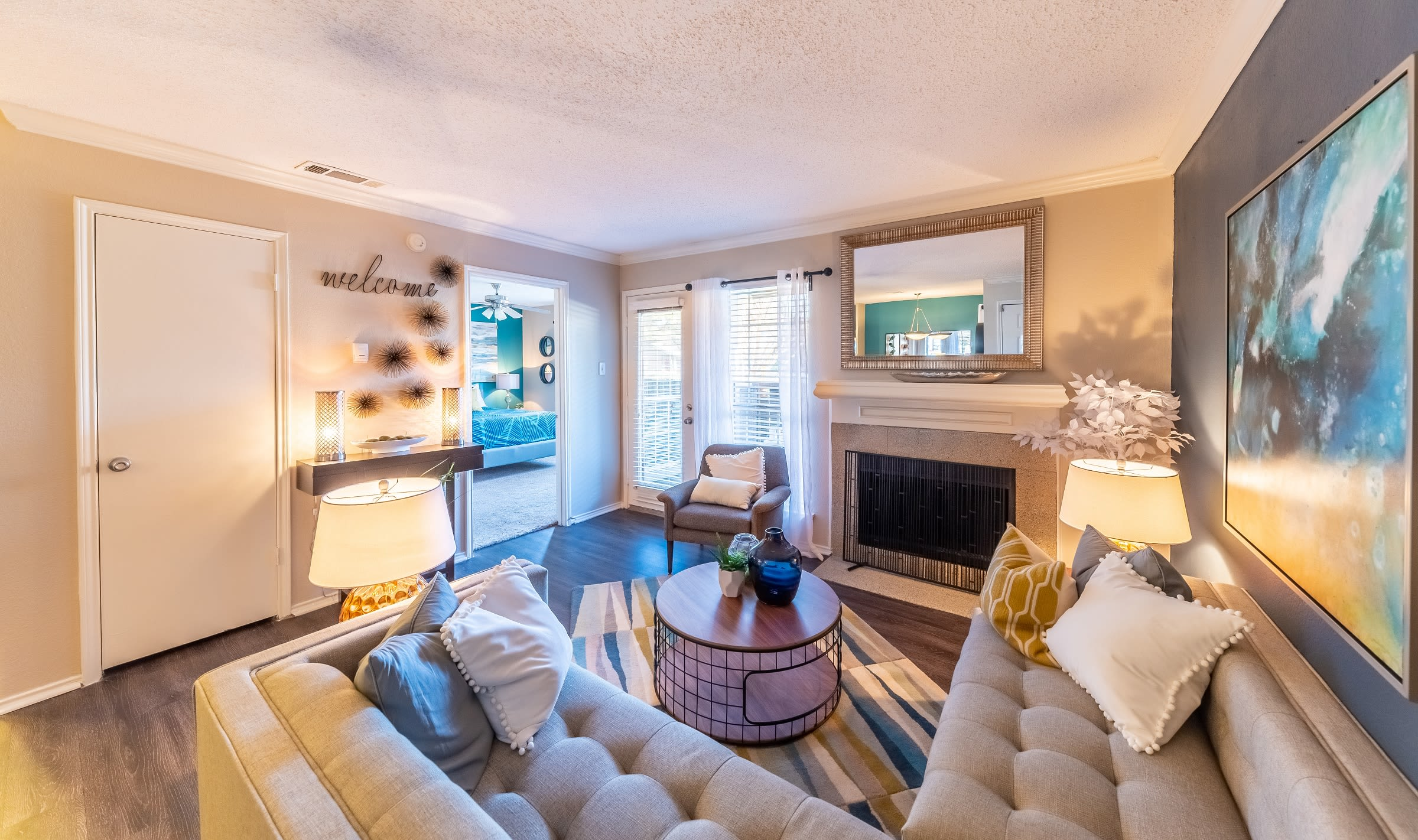 Living room with modern decor at Village Green of Bear Creek in Euless, Texas