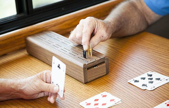 Residents playing cards at Anchor Bay at Greenwich in East Greenwich, Rhode Island.
