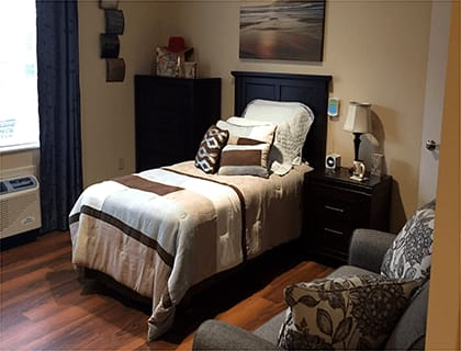 A cozy bed at Brookridge Heights