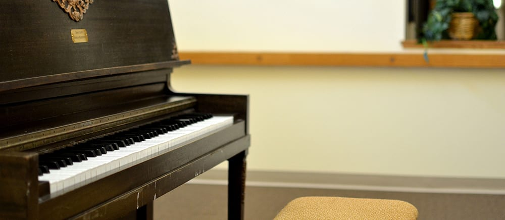 Piano at senior living in Calumet.