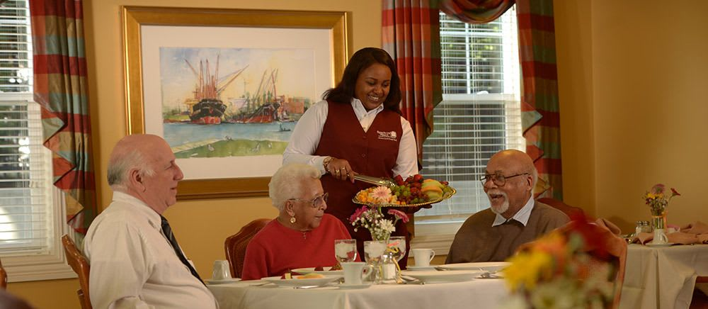 Residents being served fruit at Symphony Manor in Baltimore, Maryland