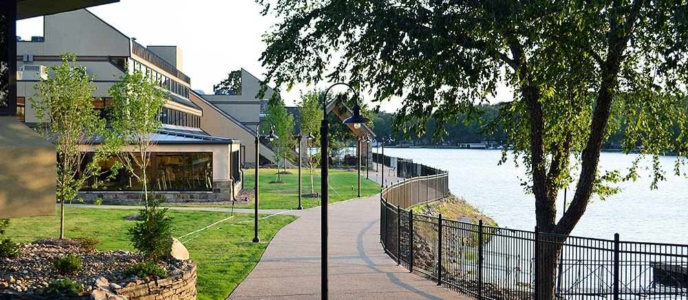 Walkways by the water at The Atrium at Serenity Pointe in Hot Springs, Arkansas.