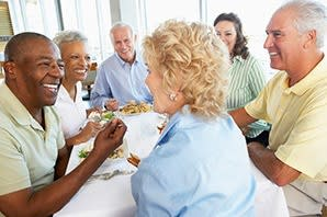 Friends enjoying brunch at the senior living community at The Atrium at Serenity Pointe in Hot Springs, Arkansas