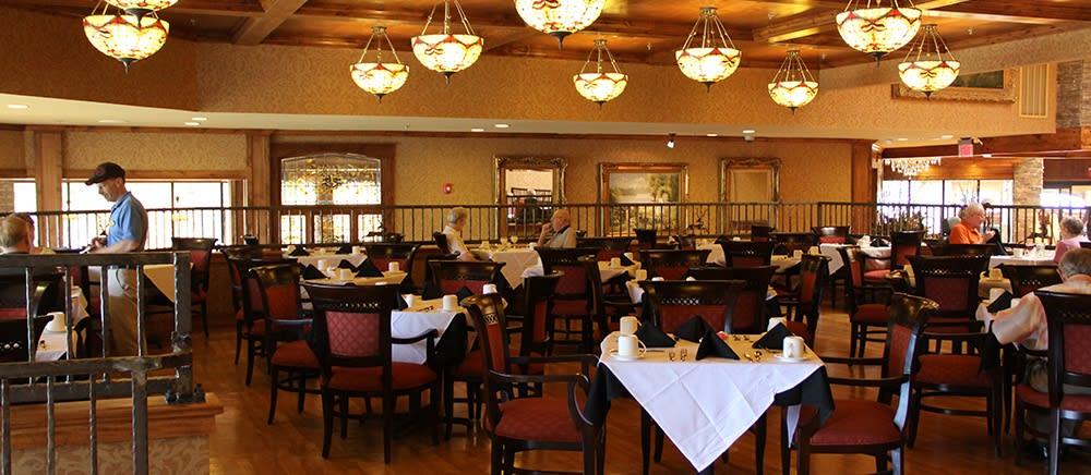 Elegant dining hall at The Atrium at Serenity Pointe in Hot Springs, Arkansas