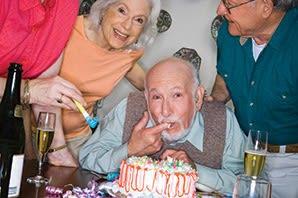 Seniors celebrating with cake at The Atrium at Serenity Pointe in Hot Springs, Arkansas