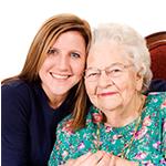 A caretaker with senior resident at Storey Oaks of Oklahoma City